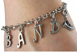 "<bR>                         EXCLUSIVELY OURS!!<BR>                   AN ALLAN ROBIN DESIGN!!<BR>   BUILD YOUR OWN CUSTOM BAND BRACELET<BR>                        LEAD & NICKEL FREE!!<BR>   W19202B - ""BAND"" LETTERS PLUS CUSTOM <Br>CHARM BRACELET FROM $8.66 TO $19.25 �2011"