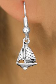 <bR>                 EXCLUSIVELY OURS!!<BR>           AN ALLAN ROBIN DESIGN!! <BR> CADMIUM, LEAD & NICKEL FREE!! <BR>W1338SE - ANTIQUED SILVER TONE <BR> SAILBOAT CHARM EARRINGS <BR>     FROM $4.50 TO $8.35 �2012