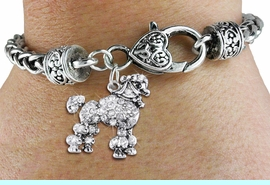 <bR>                   EXCLUSIVELY OURS!!<BR>             AN ALLAN ROBIN DESIGN!!<BR>                 LEAD & NICKEL FREE!!<BR>W1358SB - DETAILED POODLE <BR> WITH CLEAR CRYSTALS CHARM  <BR>    ON HEART LOBSTER CLASP BRACELET <Br>         FROM $5.63 TO $12.50 �2012