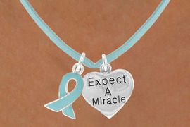 """<BR>              """"EXCLUSIVELY OURS""""<bR>          AN ALLAN ROBIN DESIGN<Br>            LEAD & NICKEL FREE!!<Br>   W13660N - TEAL AWARENESS<Br>  RIBBON & """"EXPECT A MIRACLE""""<Br>HEART ON TEAL SUEDE NECKLACE<Br>                 AS LOW AS $4.15"""