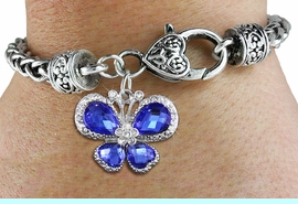 <bR>                     EXCLUSIVELY OURS!! <BR>                 AN ALLAN ROBIN DESIGN!! <BR>                     LEAD & NICKEL FREE!! <BR>    W1395SB - SILVER TONE AND BLUE <BR> CRYSTAL BUTTERFLY CHARM ON HEART <BR>       SHAPED LOBSTER CLASP BRACELET <Br>             FROM $5.63 TO $12.50 �2013