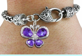 <bR>                     EXCLUSIVELY OURS!! <BR>                 AN ALLAN ROBIN DESIGN!! <BR>                     LEAD & NICKEL FREE!! <BR>   W1397SB - SILVER TONE AND PURPLE <BR> CRYSTAL BUTTERFLY CHARM ON HEART <BR>       SHAPED LOBSTER CLASP BRACELET <Br>             FROM $5.63 TO $12.50 �2013