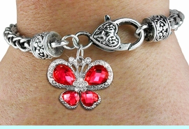 <bR>                     EXCLUSIVELY OURS!! <BR>                 AN ALLAN ROBIN DESIGN!! <BR>                     LEAD & NICKEL FREE!! <BR> W1398SB - SILVER TONE AND RUBY RED <BR> CRYSTAL BUTTERFLY CHARM ON HEART <BR>       SHAPED LOBSTER CLASP BRACELET <Br>             FROM $5.63 TO $12.50 �2013