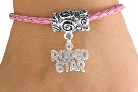 """<bR>               EXCLUSIVELY OURS!!<Br>         AN ALLAN ROBIN DESIGN!!<Br>              LEAD & NICKEL FREE!!<Br>W16134B - """"RODEO STAR"""" CHARM<Br> PINK BRAIDED TOGGLE BRACELET<Br>              FROM $3.94 TO $8.75"""