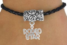 """<bR>                  EXCLUSIVELY OURS!!<Br>            AN ALLAN ROBIN DESIGN!!<Br>                 LEAD & NICKEL FREE!!<Br>W16140B - """"RODEO STAR"""" CHARM &<Br>  BLACK BRAIDED TOGGLE BRACELET<Br>                 FROM $3.94 TO $8.75"""