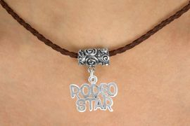 """<bR>               EXCLUSIVELY OURS!!<Br>         AN ALLAN ROBIN DESIGN!!<Br>              LEAD & NICKEL FREE!!<Br>W16149N - """"RODEO STAR"""" CHARM<Br>       BROWN BRAIDED NECKLACE<Br>             FROM $4.50 TO $10.00"""