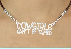 """<BR>                       EXCLUSIVELY OURS!!<Br>                AN ALLAN ROBIN DESIGN!!<bR>                      LEAD & NICKEL FREE!!<Br>W16361N - """"COWGIRLS CAN'T BE TAMED""""<Br>  MARQUEE PENDANT & BROWN BRAIDED<Br> NECKLACE FROM $6.75 TO $15.00 &#169;2010"""