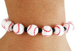 <bR>           EXCLUSIVELY OURS!!<BR>     AN ALLAN ROBIN DESIGN!! <Br> W3497B - BASEBALL STRETCH<BR>BRACELET FROM $4.50 TO $10.00