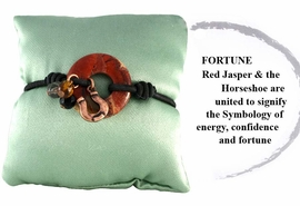"<br>                      EXCLUSIVELY OURS!!! <BR>W10783B - GENUINE RED JASPER STONE<BR>        & HORSESHOE DROP ""FORTUNE""<bR>     SYMBOLOGY STRETCH BRACELET &<bR>    KEEPSAKE PILLOW AS LOW AS $6.85"
