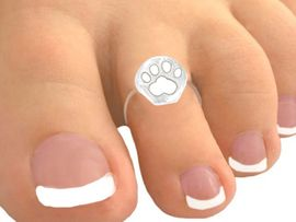 <Br>            EXCLUSIVELY OURS!<bR>       W9512TR - PURE WHITE<br>PAW PRINT STRETCH TOE RING<bR>               AS LOW AS $1.30