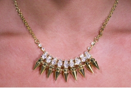 <Br>            LEAD AND NICKEL FREE!! <Br>     W19802NE - DARING GOLD TONE <BR> SPIKES AND STUDS NECKLACE WITH <BR>CLEAR FACETED SPARKLING CRYSTALS AND <Br> MATCHING STUD AND SPIKE EARRINGS <BR>             FROM $6.19 TO $13.75