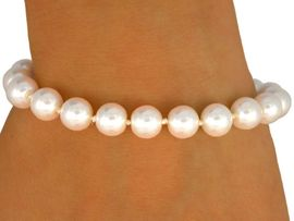 <BR>         EACH PEARL IS KNOTTED BY HAND <BR>                 LEAD AND NICKEL FREE!!<BR>W9421B - SINGLE ROW 8 MM GLOSSY <Br>           CREAM FAUX PEARL STRETCH<Br>         BRACELET FROM $5.25 TO $10.00