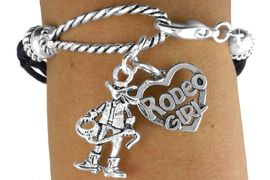 """<Br>               LEAD & NICKEL FREE!!<Br>                EXCLUSIVELY OURS!!<Br>          AN ALLAN ROBIN DESIGN!!<Br>W14571B - 2-CHARM BLACK MULTI<BR>    STRAND COWGIRL """"RODEO GIRL""""<Br>   ROPE BRACELET AS LOW AS $4.73"""