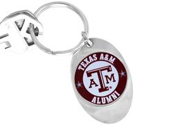 """<Br>               LEAD & NICKEL FREE!!<Br>         STERLING SILVER PLATED!!<bR>W14308KC - LICENSED TEXAS A&M<Br>        UNIVERSITY """"AGGIES"""" LOGO<Br>        KEY CHAIN AS LOW AS $1.99"""