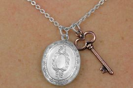 <Br>                  LEAD & NICKEL FREE!!<Br> W17860N - OVAL ANTIQUED SILVER<Br> FINISH LOCKET WITH COPPER TONE<br>KEY NECKLACE FROM $3.35 TO $7.50