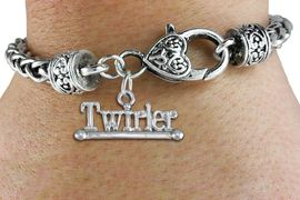 """<bR>    WHOLESALE FASHION CHARM BRACELET <BR>                     EXCLUSIVELY OURS!! <BR>                AN ALLAN ROBIN DESIGN!! <BR>          CADMIUM, LEAD & NICKEL FREE!! <BR>        W1551SB - BEAUTIFUL SILVER TONE  <BR>""""TWIRLER"""" WITH BATON CHARM & HEART CLASP <BR>      BRACELET FROM $4.40 TO $9.20 �2013"""