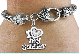 """<BR>  WHOLESALE HEART FASHION JEWELRY <bR>                   EXCLUSIVELY OURS!! <Br>              AN ALLAN ROBIN DESIGN!! <BR>        LEAD, NICKEL & CADMIUM FREE!! <BR>   W1563SB - ANTIQUED SILVER TONE AND <BR>CLEAR CRYSTAL """"I LOVE MY SOLDIER"""" HEART CHARM <BR>      ON HEART LOBSTER CLASP BRACELET <Br>        FROM $5.98 TO $12.85 �2014"""