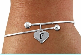 <BR>NICKEL FREE & ADJUSTABLE BRACELET !<br>       PERSONALIZED INITIAL BRACELET <bR>                  EXCLUSIVELY OURS!! <Br>             AN ALLAN ROBIN DESIGN!! <BR>    CLICK HERE TO SEE 1000+ EXCITING <BR>          CHANGES THAT YOU CAN MAKE! <BR>                LEAD & NICKEL FREE!! <BR>W1669SB - SILVER TONE HEART SHAPED  <BR>ALPHABET INITIAL CHARM ON ADJUSTABLE <Br>SOLID WIRE BRACELET FROM $4.15 TO $8.00