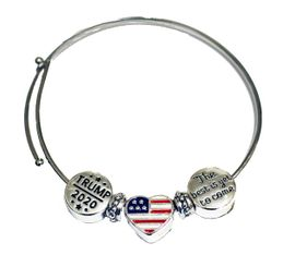 """<B>NEW! TRUMP 2020 ADJUSTABLE MIRACLE WIRE BRACELET</B><BR>WITH HEART AMERICAN FLAG CHARM, AND """"THE BEST IS YET TO COME"""" CHARMS.<BR> HYPOALLERGENIC-SAFE NO NICKEL, LEAD, OR POISONOUS CADMIUM<BR>W196-197-198B9 $8.99 EACH �2020"""