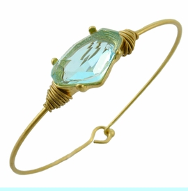 <BR>     W29479B12 - EXCITING NEW FASHION JEWELRY EXCLUSIVE <BR>      LARGE BRIGHT CRYSTAL ON MIRACLE WIRE BRACELET <BR>    ADJUSTABLE GOLD TONE WIRE WITH BALL AND HOOK CLASP<BR>                     NO NICKEL, LEAD, OR POISONOUS CADMIUM.  <br>                              BUY THIS BRACELET FOR $10.00 EACH