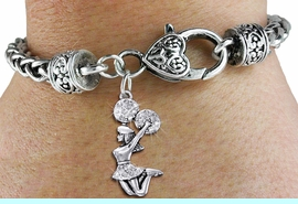 <BR>      WHOLESALE CHEERLEADER JEWELRY<bR>            EXCLUSIVELY OURS!! <BR>       AN ALLAN ROBIN DESIGN!! <BR>          LEAD & NICKEL FREE!! <BR> W1409SB - SILVER TONE AND CRYSTAL <BR>  JUMPING CHEERLEADER CHARM ON <BR>  HEART LOBSTER CLASP BRACELET <Br>             $10.38 EACH �2013