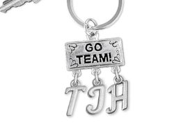 "<br> WHOLESALE JUNIOR HIGH SCHOOL KEY RING<Br>                  EXCLUSIVELY OURS!!<Br>            AN ALLAN ROBIN DESIGN!!<Br>                 LEAD & NICKEL FREE!! <BR>       THIS IS A PERSONALIZED ITEM <Br> W20099KC - SILVER TONE ""GO TEAM!"" <BR> CHARM ON CUSTOM KEY RING WITH <BR>  YOUR JUNIOR HIGH SCHOOL INITIALS <BR>        FROM $6.41 TO $14.25 �2013"
