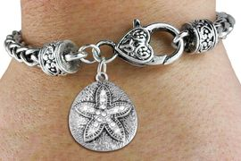<BR>      WHOLESALE SAND DOLLAR JEWELRY<bR>             EXCLUSIVELY OURS!! <BR>        AN ALLAN ROBIN DESIGN!! <BR>           LEAD & NICKEL FREE!! <BR> W1422SB - SILVER TONE SAND DOLLAR <BR> CLEAR CRYSTAL ACCENTED CHARM ON <BR>   HEART LOBSTER CLASP BRACELET <Br>     FROM $5.63 TO $12.50 �2013