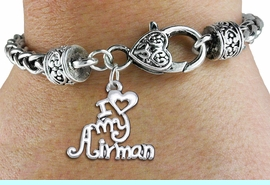 """<bR>       WHOLESALE USAF CHARM BRACELET <BR>                     EXCLUSIVELY OURS!! <BR>                AN ALLAN ROBIN DESIGN!! <BR>          CADMIUM, LEAD & NICKEL FREE!! <BR>        W1501SB - BEAUTIFUL SILVER TONE  <BR>  """"I LOVE MY AIRMAN"""" CHARM & HEART CLASP <BR>      BRACELET FROM $4.64 TO $8.75 �2013"""