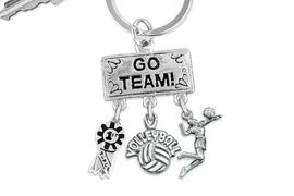 "<BR>      WHOLESALE VOLLEYBALL KEY CHAIN<Br>                   EXCLUSIVELY OURS!! <Br>              AN ALLAN ROBIN DESIGN!! <Br>                 LEAD & NICKEL FREE!! <BR>    W20200KC - SILVER TONE ""GO TEAM!"" <BR>      VOLLEYBALL THEMED KEY RING WITH <BR> 1st MEDAL, ""VOLLEBALL"" & SERVE CHARMS <BR>           FROM $6.41 TO $14.25 �2013"