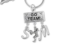 "<BR>      WHOLESALE VOLLEYBALL KEY RING<Br>                    EXCLUSIVELY OURS!! <Br>               AN ALLAN ROBIN DESIGN!! <Br>                  LEAD & NICKEL FREE!! <BR>         THIS IS A PERSONALIZED ITEM!! <BR>     W20215KC - SILVER TONE ""GO TEAM!"" <BR>       VOLLEYBALL THEMED KEY RING WITH <BR>  BUMP CHARM AND YOUR PERSONAL INTIALS <BR>            FROM $6.41 TO $14.25 �2013"