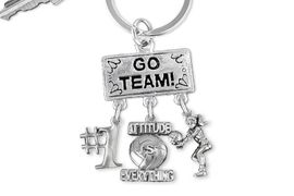 "<BR>      WHOLESALE VOLLEYBALL KEYCHAIN<Br>                    EXCLUSIVELY OURS!! <Br>               AN ALLAN ROBIN DESIGN!! <Br>                  LEAD & NICKEL FREE!! <BR>     W20213KC - SILVER TONE ""GO TEAM!"" <BR>       VOLLEYBALL THEMED KEY RING WITH <BR> ""#1"", ""ATTITUDE IS EVERYTHING"", AND BUMP <BR>    CHARMS FROM $6.41 TO $14.25 �2013"