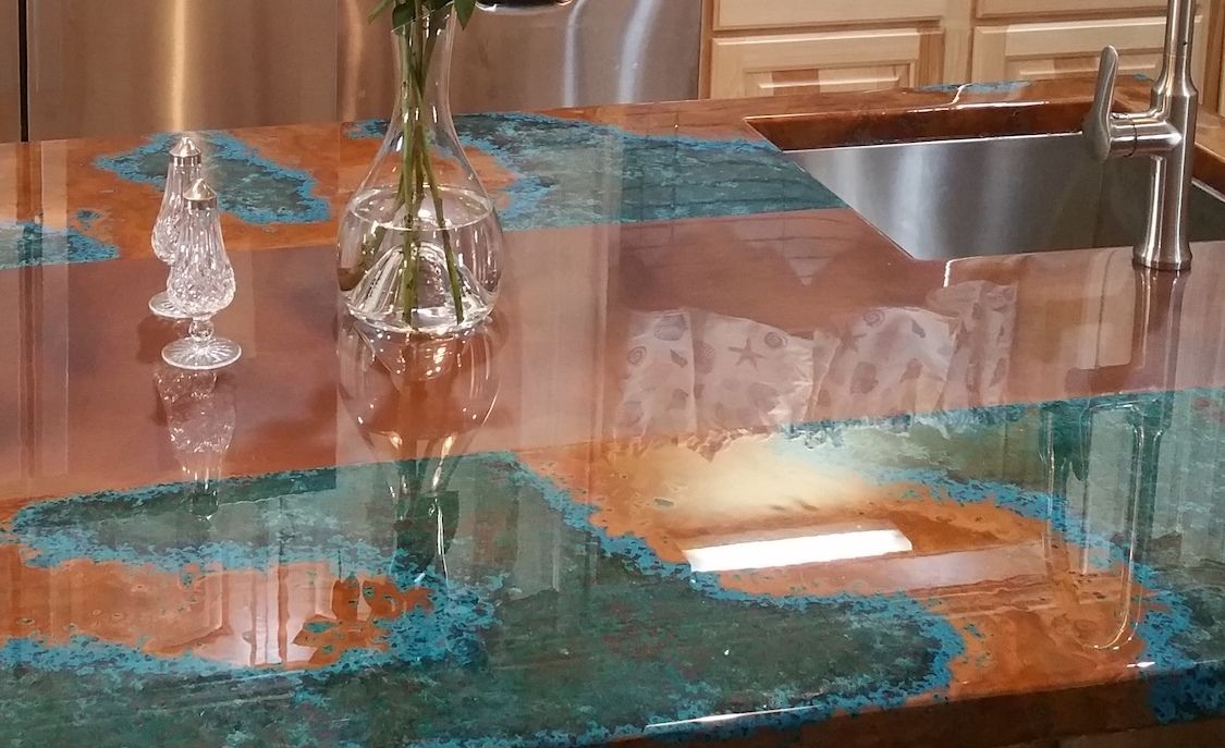 Azul and Rustic Copper Countertop and Backsplash