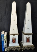 Decorated porcelain parcel-gilt mounted obelisks