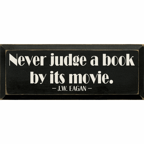 Famous Quotes Sign...Never Judge A Book By Its Movie. - J.W. Eagan