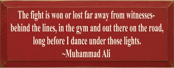 Famous Quotes Sign...The Fight Is Won Or Lost Far Away From Witnesses... - Muhammad Ali