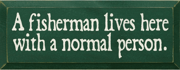 Funny Sign...A Fisherman Lives Here With A Normal Person