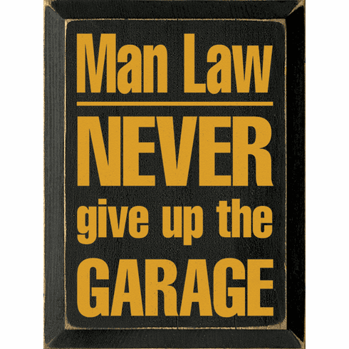 Funny Sign...Man Law - Never Give Up The Garage
