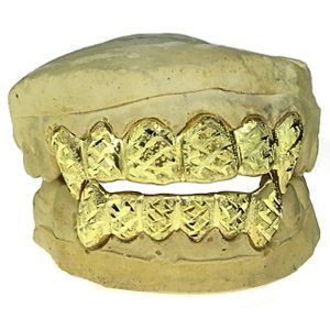 Gold Plated Dust Diamond-Cut Custom Fang Grillz