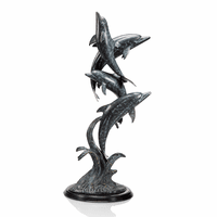 Synchronized Swimming Dolphin Statue