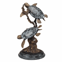 Two Lighthearted Turtles Sculpture