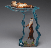 Two Sea Otters and a Clam Figurine