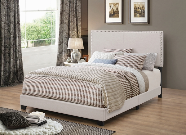 Boyd Ivory Fabric Upholstered Queen Panel Bed by Coaster