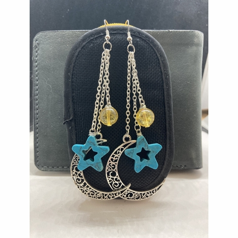 Moon and star dangle earrings with amber bead