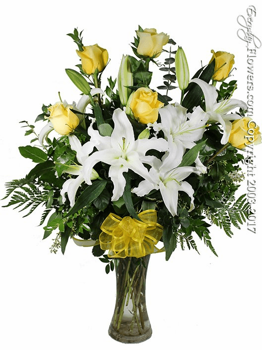 The Yellow Rose Bouquet Featuring White Lilies