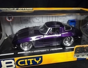 Jada 90327     --    1963 Chevy Corvette Sting Ray  /  DUB City includes diecast sign & mail box   1:18
