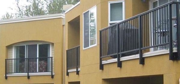 House view showing off multiple balconies with bronze aluminum picket railings