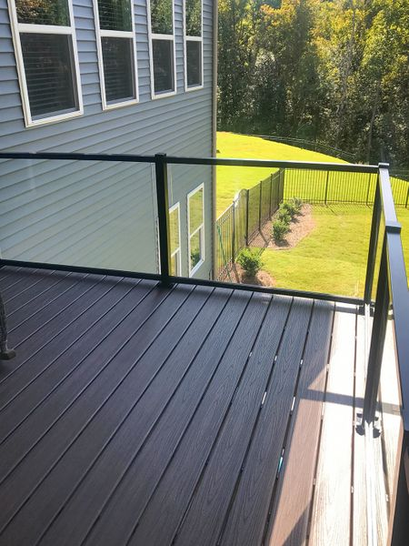 Black glass railing on a deck in Concord, NC