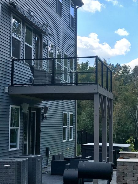 View of a deck with glass railing in Concord, NC