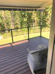 View from a deck with glass railing in Concord, NC