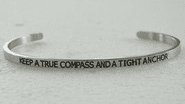 KEEP A TRUE COMPASS AND A TIGHT ANCHOR